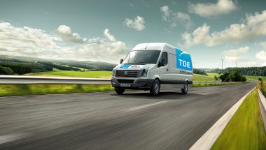 Van on delivery tour through German countryside